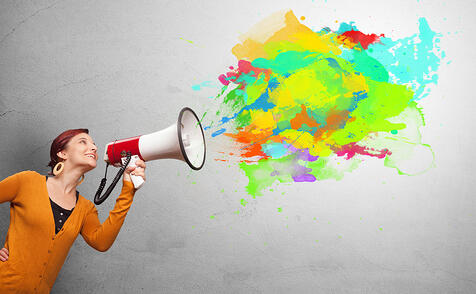Person with megaphone and colorful splashes-1